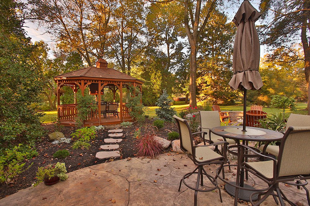 Decorative stamped concrete patio with gazebo and firepit